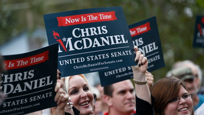Supporters of second-term state Sen. Chris McDaniel, R-Ellisville, hoist campaign signs as he announces his candidacy for the U.S. Senate in 2014, during a rally at the Jones County Courthouse in Ellisville on Oct. 17, 2013. His decision to run will likely pit him against longtime incumbent Republican U.S. Sen. Thad Cochran in the Republican primary.