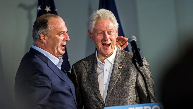 U.S. Rep. Dan Kildee, D-Flint Township, Mich., left, with former president Bill Clinton, joined Michigan's Democratic members of Congress to ask the Justice Department to investigate a Michigan oversight board for its role in taking steps to bar Flint, Mich., from suing the state.