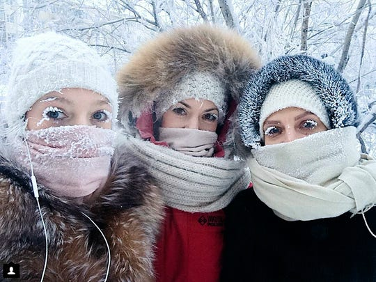 Anastasia Gruzdeva, left, poses for a selfie with her friends on Jan. 13, 2018, as the temperature dropped to about 58 degrees below zero in Yakutsk, Russia.