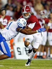 File-This Oct. 1, 2016, file photo shows Alabama quarterback Jalen Hurts (2) being tackled by Kentucky linebacker Courtney Love (51) during the second half of an NCAA college football game in Tuscaloosa, Ala. Love chalks up his promising season anchoring Kentucky's defense to finally getting the chance to regularly play. Now, the senior middle linebacker's goal to help make the Wildcats one of the Southeastern Conference's best defensive units. Love was the Wildcats' third-leading tackler in 2016 with 76 stops, which he believes should have been higher. But it provided an encouraging baseline for the Nebraska transfer, whose leadership has already earned the attention of national award committees.(AP Photo/Butch Dill, File)
