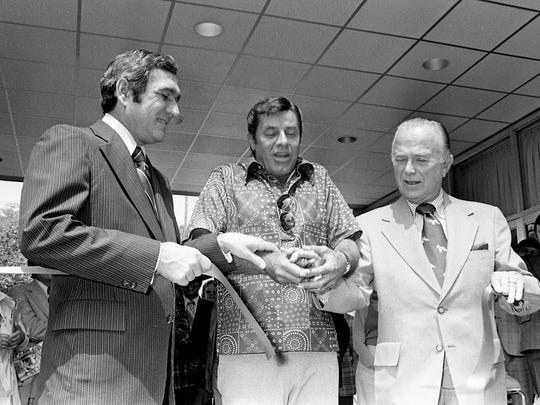 Jerry Lewis, center, with the support of Gov. Ray Blanton, left, and Ray Kroc, chairman of the board of McDonald's Corp., cut the ribbon to formally open the Jerry Lewis Neuromuscular Disease Research Center on the Vanderbilt University campus on June 25, 1975.