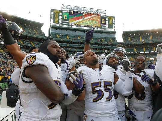 Baltimore Ravens players celebrate after an NFL football game against the Green Bay Packers Sunday, Nov. 19, 2017, in Green Bay, Wis. The Ravens won 23-0. (AP Photo/Jeffrey Phelps)