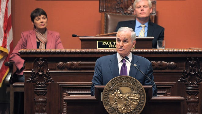 Gov. Mark Dayton delivers his State of the State address before a joint session of the Legislature on Wednesday in St. Paul. Seated behind are President of the Senate Sandra Pappas (left) and House Speaker Paul Thissen.