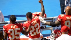 Chiefs CB Marcus Peters (22) protests next to RB Charcandrick