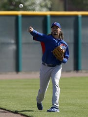Chicago Cubs starting pitcher Jeff Samardzija (29) warms up during camp at Chicago Cubs training facility at Mesa.