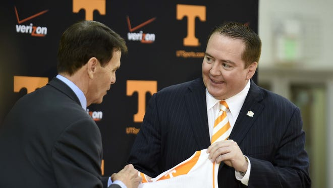 Donnie Tyndall, right, is introduced as Tennessee men's basketball coach by athletic director Dave Hart during a news conference Tuesday, April 22, 2014, in Knoxville, Tenn. The former Southern Mississippi coach succeeds Cuonzo Martin, who resigned last week to take the coaching job at California. (AP Photo/Knoxville News Sentinel, Amy Smotherman Burgess)