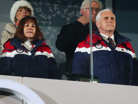 Mike Pence and his wife Karen during the opening ceremony.