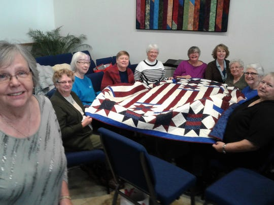 Organizer Pat Fish, left, is shown with some of her quilters, seated, from left, Twilla Meyer, Lois Ludvigson, Judy Taylor, Glenda Sivers, Chris Keyser, Pastor Katie Lowe Lancaster, Marilu Kuhl, Mary Nehring and Terry Hall.