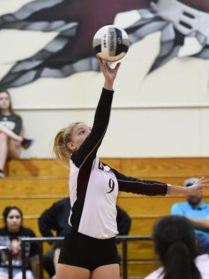 Bastrop senior Layne Ellsworth (9) makes a play on the ball.