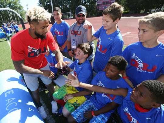 Giants star wide receiver Odell Beckham Jr. gives some