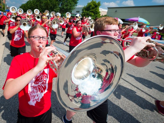 Katie Randall performs with the Fishers High School Tiger Band in the parade. The community of Fishers celebrated their annual Fishers Freedom Festival, Sunday, June 26, 2016,  with a parade, games and food.