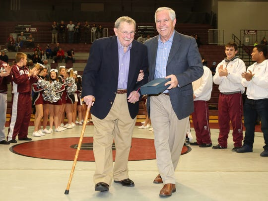 Dowling President Jerry Deegan, right, honors former