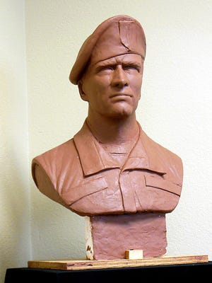 A clay model of Ron Moore's sculpture to honor veterans of America's longest war.