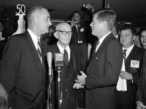 Vice President Lyndon B. Johnson, left, and President John F. Kennedy attend a dinner for Sen. Carl Hayden in Arizona.