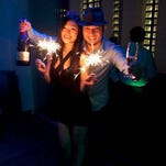 Jason JD Iriarte, right, celebrates New Year's Eve with wife Hannah at Zen Ultra Lounge in Tumon on Dec. 31, 2011.