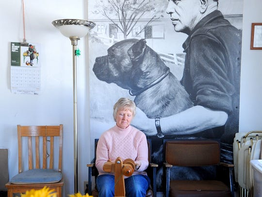 Pam Hughes of Mount Vernon spins fabric on March 9 at Malabar Farm.