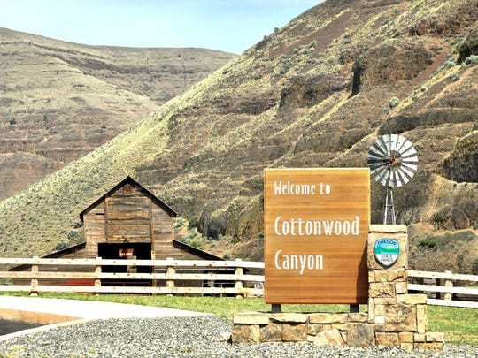 The entrance sign welcomes visitors to Cottonwood Canyon. The Murtha ranch barn is seen in the back.