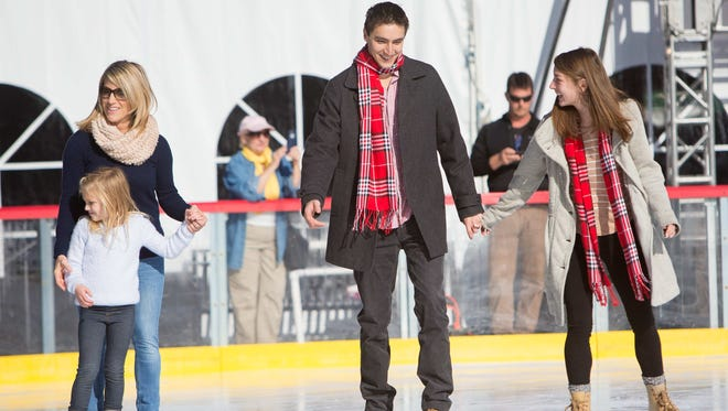 Jennifer O'Neil (from left) of Wilmington skates with her daughter McKenna, 6, along with John Cannarella and Hilary Wayland at the Riverfront Rink.