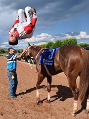 Jockey G.R. Carter, Jr.'s trademark back flip dismount.