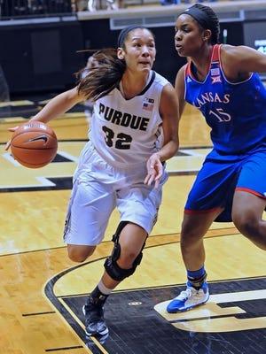 Senior Forward Whitney Bays drives the ball to the basket for the Boilermakers past Kansas Senior Chelsea Gardner.