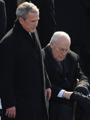 Former president George W. Bush and former vice president Dick Cheney attend President Obama's inauguration in January 2009.