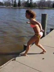 Kayla Jacob, 16, of Lamartine, prepares to jump into