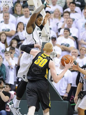 Michigan State's Branden Dawson and Iowa's Aaron White