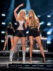 Miranda Lambert and Carrie Underwood perform during