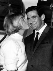 Rod Taylor, Australian movie star, celebrates his 35th birthday by working on the set of 'Do Not Disturb,' and gets a big birthday kiss from co-star Doris Day on Jan. 14, 1965.