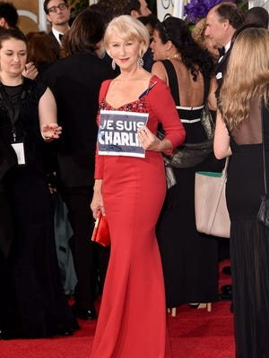 """Helen Mirren holds up her """"Je Suis Charlie"""" sign at the 72nd annual Golden Globe Awards on Jan. 11, 2015."""