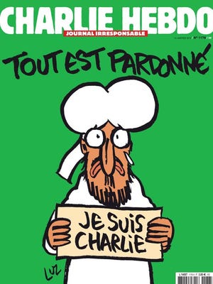 """A handout released on January 12, 2015, in Paris by French newspaper Charlie Hebdo shows the frontpage of the upcoming """"survivors"""" edition of the French satirical weekly with a cartoon of the Prophet Mohammed holding up a """"Je suis Charlie"""" ('I am Charlie') sign under the words: """"Tout est pardonne"""" ('All is forgiven')."""