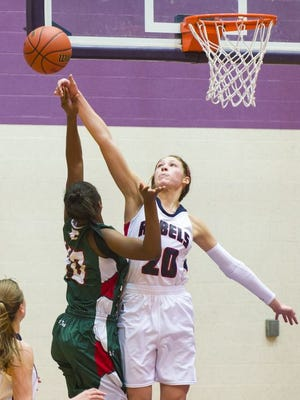 Roncalli High School junior Lindsey Corsaro  blocks a shot during a Dec. 13, 2014, game Ben Davis High School.