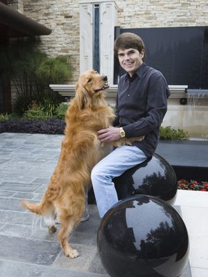 Dean Koontz at his home in Newport Beach, Calif., with his dog Anna.