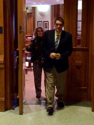 Cory DesArmo exits the courtroom Thursday after being found guilty of 11 counts of molestation. (Photo: )