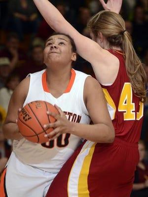 Washington sophomore Sydney Arrington weaves around Roosevelt's Kelley Criddle