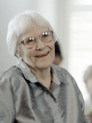 Author Harper Lee smiles during a ceremony in Montgomery