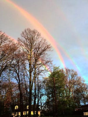 A Long Island, N.Y. commuter snapped a picture of a quadruple rainbow while waiting for her train this morning.