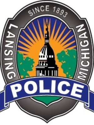 A man died in Lansing police custody after being arrested on Monday.