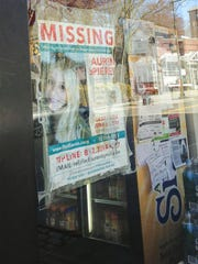 A poster seeking information about the disappearance