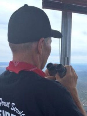 """He's the eye in the sky watching over the 1.6 million acres of the Kaibab National Forest, and he does it all from a 7-foot by 7-foot observation room at 9,500 feet elevation.  """"I'm looking for smoke and it's hard,"""" said Jeff Newton, a wildfire lookout for the Kaibab National Forest. """"It's like looking for a needle in a haystack.""""  Newton, a former firefighter, is in his third season as a lookout stationed on the Bill Williams Mountain. The lookout has been used by the U.S. Forest Service for 100 years and the tower he calls his office is about 75 years old.  During the summer months, Newton lives in modest quarters at the base of the tower and takes the stairs up to his office with a 360 degree view of northern Arizona. From his perch, Newton can point out Mount Elden in the east and the Grand Canyon to the north. He said he can see for 50 to 80 miles on a clear day, but he has also seen his fair share of wild weather.  """"I'm looking right there and this lightning bolt came down and -- bam -- it blew up a tree right in front of me,"""" he said.  For eight hours a day, Newton is scanning and observing for possible wildfires. He is in constant contact with dispatch, relaying weather information and reporting suspicious smoke. His is often the first person to spot any potential flames.  """"You get in that forest and it's rugged and there's a lot of trees and you can't see far and you can't always drive your truck right to the fire,"""" he said.  He aids firefighters on the ground by helping to navigate crews to the source of the smoke and provides weather updates.  """"It's very critical to jump on that fire as soon as possible, so you can make a decision as to whether you can manage or suppress the fire,"""" he said.  Newton is from Palm Springs, Calif. and is a teacher currently pursuing his doctorate degree in mathematics and physics. He said the solitude of his job actually provides a lot of study time.  """"The primary purpose of me being out here is to pay for my schooling,"""" he s"""