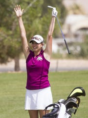 Desert Hills' Katie Perkins reacts after sinking an eagle on the 18th hole in the first round of the 3A state tournament at Bloomington Country Club, May 2015.