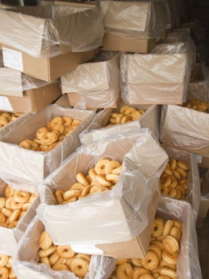 Cartons containing 78 doughnuts each, totaling 24,000, were donated by Meijer for a record-breaking attempt at the Hamburg Family Fun Fest. The effort, if successful, will be recorded in the Guinness Book of World Records.