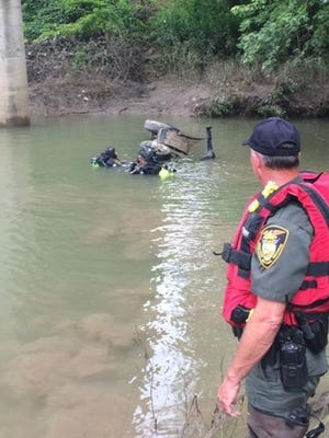 Warren County divers work to remove a vehicle submerged in a creek under Indiana 63