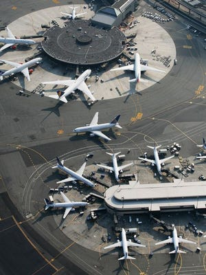 This file photo from Aug. 29, 2007, shows passenger planes at Newark International Airport.