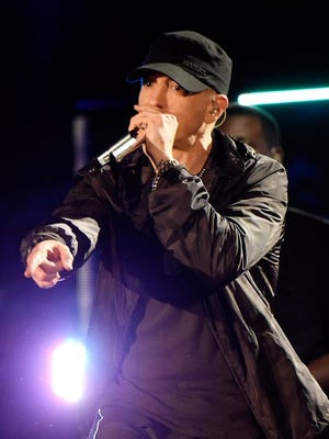 """Eminem performs onstage during """"The Concert For Valor"""" at the National Mall on Nov. 11, 2014, in Washington, D.C."""