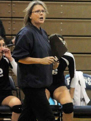 Kelly Graham, a 27-year Livonia Public Schools  employee who was the head volleyball coach at Stevenson High, won two Class A regional titles in three years. She was accused of embezzling locker deposits.