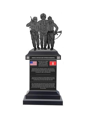 The design of the Hmong-Lao Vietnam War Veterans Memorial includes two Hmong men helping an American soldier.