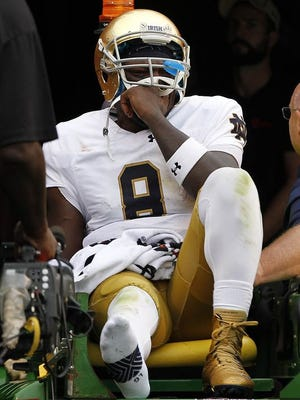 Notre Dame quarterback Malik Zaire suffered a right ankle injury during the Irish game against Virginia.