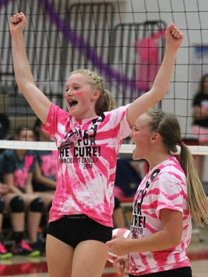 Wausau East's Ally Geurink, left, and Kylie Leverette celebrate a point during last year's Volley for the Cure game against Wausau West.