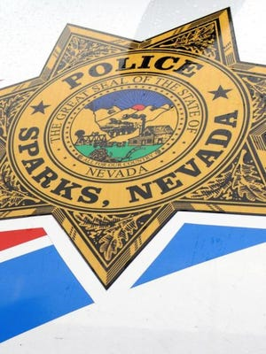 A file photo of the Sparks Police Department logo.Police are investigating a situation a Sparks home involving a man with a gun on Monday.